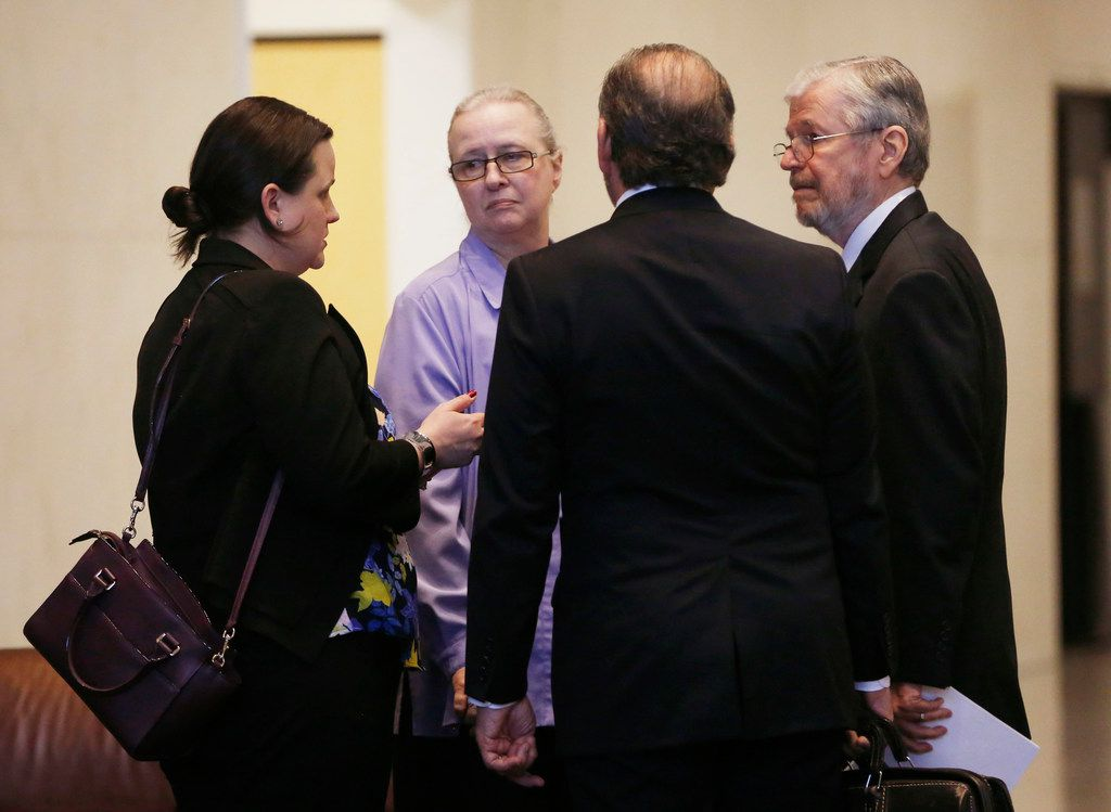 Former Dallas County Schools board president Larry Duncan (far right) speaks with his family before leaving Earle Cabell Federal Building after his sentencing on Tuesday, April 9, 2019. Duncan was sentenced to three years probation for tax evasion, six months home confinement and must pay $45,163 in restitution.