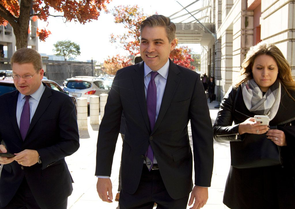 CNN's Jim Acosta walks away from the U.S. District Courthouse, Friday, Nov. 16, 2018, in Washington, D.C., after a hearing.  U.S. District Court Judge Timothy Kelly ordered the White House to immediately return Acosta's credentials.