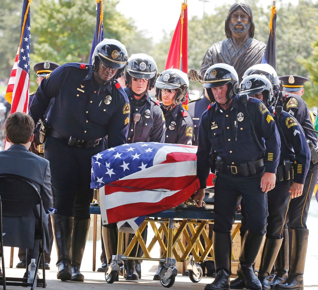 """Dallas Police motorcycle officers escorted the casket of Senior Cpl. Earl James """"Jamie"""" Givens to the hearse after funeral services  at Prestonwood Baptist Church in Plano on Thursday, July 26, 2018."""