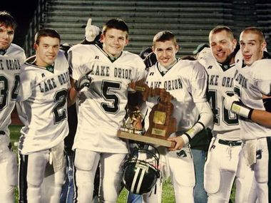 Jeff Heath celebrates with his Lake Orion High School teammates after defeating Sterling Heights Stevenson High School, 38-36, in a regional championship game. Heath kicked a 49-yard field goal with two seconds remaining to win the game. Lake Orion would advance to the 2008 Michigan state championship game at Ford Field in Detroit for the first time in school history. Heath is now a starting safety and team captain for the Dallas Cowboys.