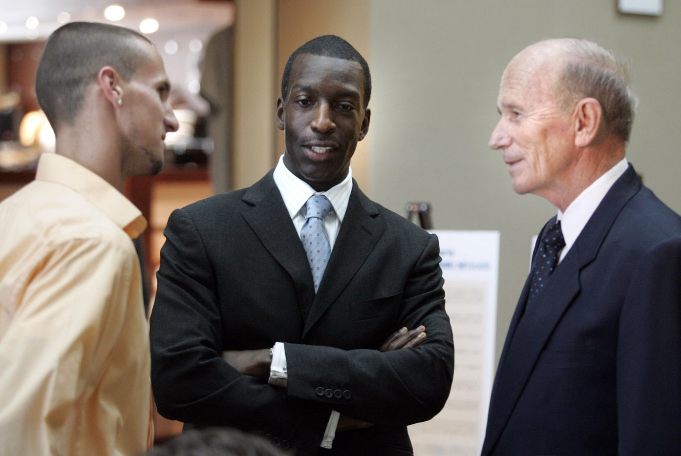 From left to right: Jeremy Wariner, Michael Johnson and Dr. Kenneth Cooper visit before a press conference at Cooper Aerobics Center at Craig Ranch in McKinney on Wednesday, June 28, 2006. Olympic Champion Michael Johnson has teamed with Dr. Kenneth Cooper to build a world class athletic performance training and research center at McKinney's Craig Ranch.