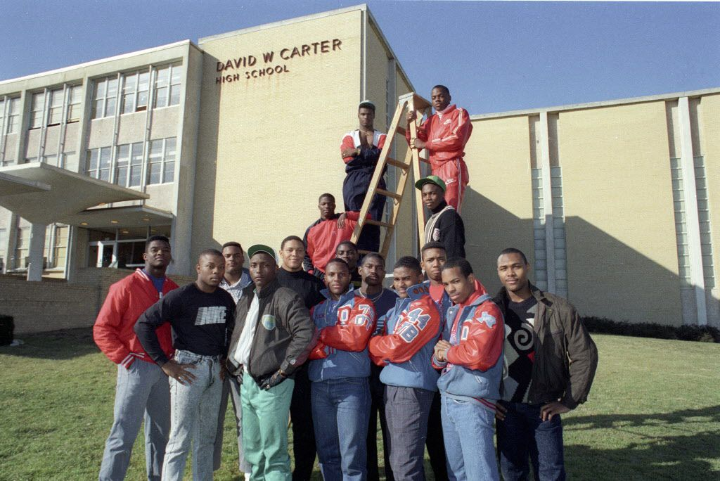 Group of about 16 football players from Carter High School who are being recruited by colleges. (Left to right) Front row: Ivory Dillard, Anthony Allen, P.K. Williams, Carlos Allen, Stephen McKnight, Cedric Buckley. Second row: Greg Hill, Tracie Perry, Joe Burch, Richard Thomas, Derrick Cherry, Joseph Tips. Ladder left: Gary Edwards, Jessie Armstead. Top right: Derric Evans, Le Shai Maston.