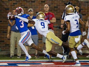 SMU Mustangs wide receiver James Proche (3) catches a pass in the end zone for a touchdown ahead of Tulsa Golden Hurricane cornerback Reggie Robinson II (9) during the fourth quarter of an NCAA football game between Tulsa and SMU on Saturday, October 5, 2019 at Ford Stadium on the SMU campus in Dallas.
