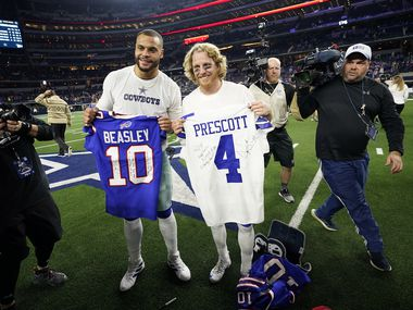 FILE - Cowboys quarterback Dak Prescott (left) exchanges jerseys with Bills wide receiver Cole Beasley after a game at AT&T Stadium on Thursday, Nov. 28, 2019, in Arlington.