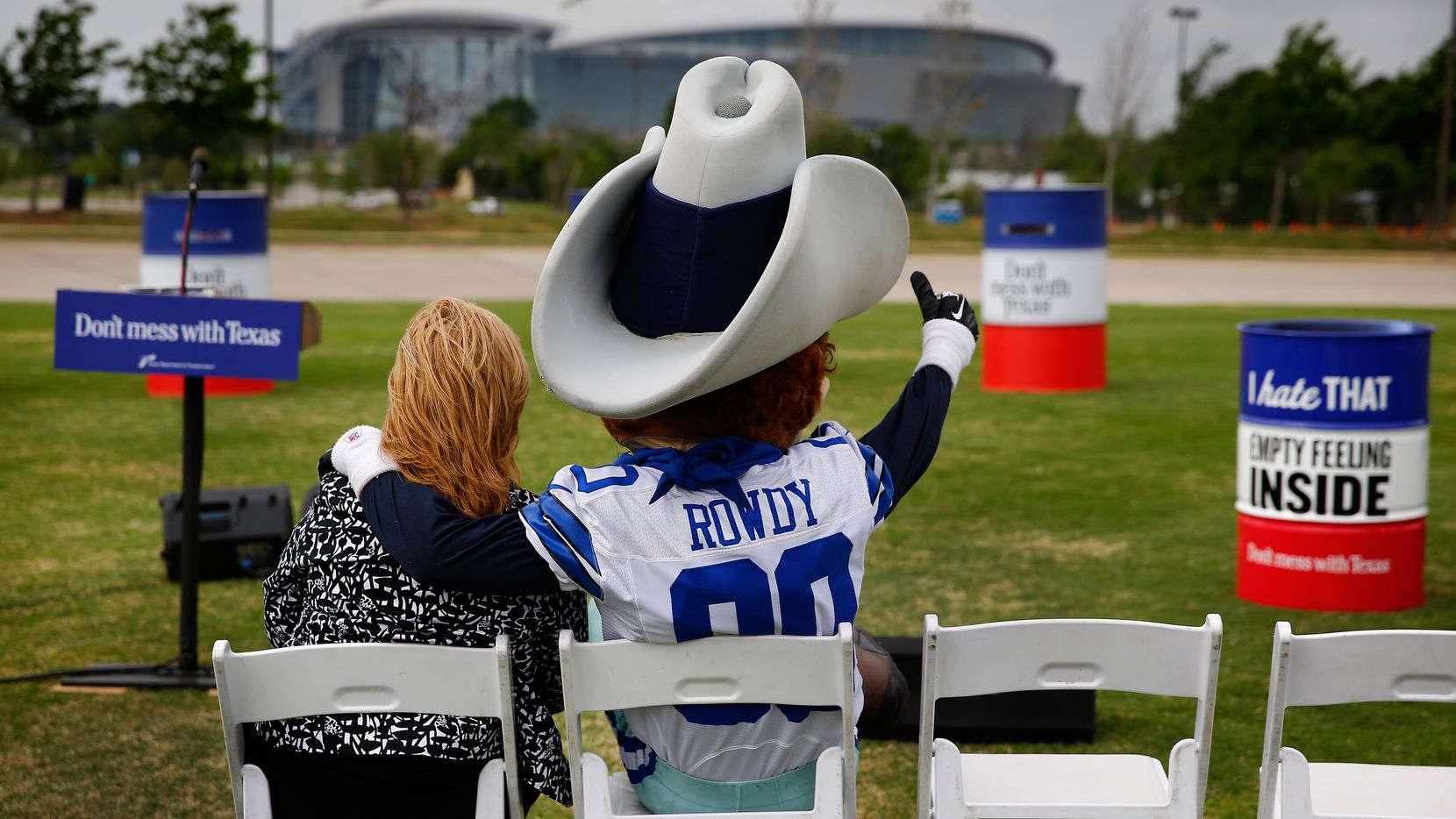 Dallas Cowboys mascot Rowdy hung out with TxDOT's Brenda Flores-Dollar before a Don't Mess With Texas event near the Cowboys' stadium in April.