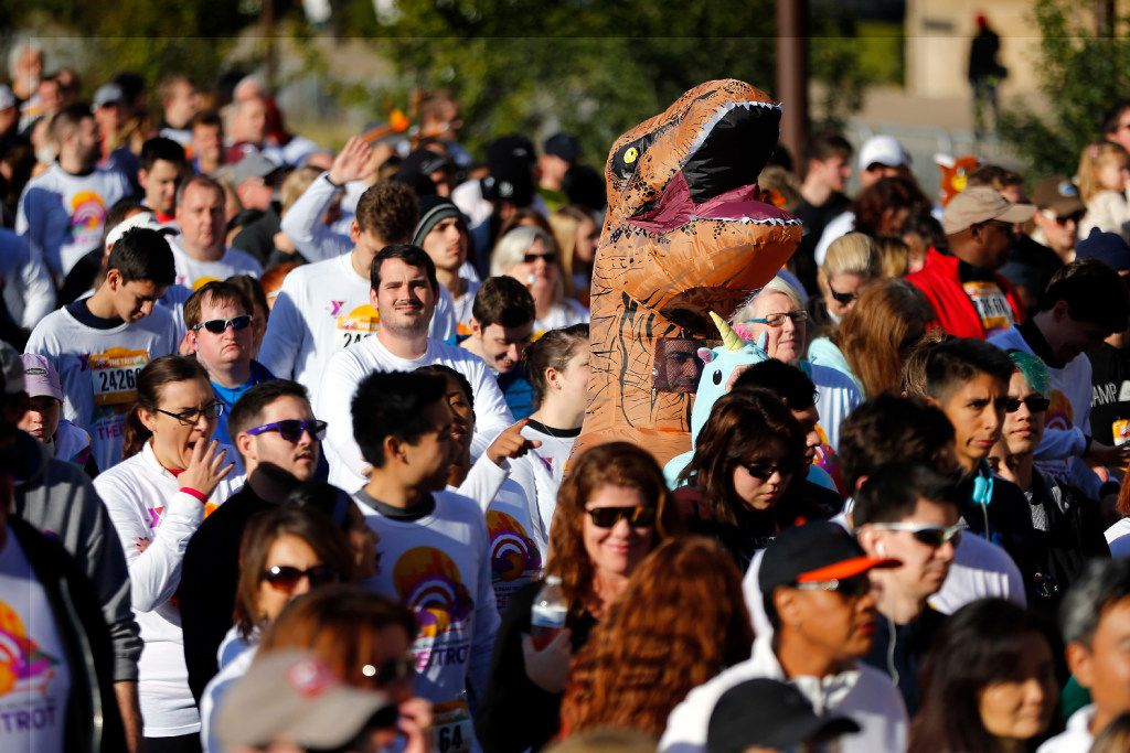 Runners participated in the 49th annual Dallas YMCA Turkey Trot in downtown Dallas in 2016. For its 50th year, race organizers expect a crowd of 25,000 or more.