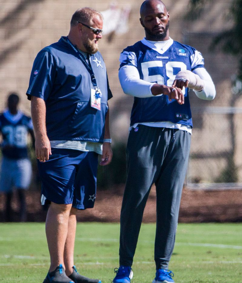 Dallas Cowboys defensive end Robert Quinn (58) talks with a member of Cowboys security during an afternoon practice at training camp in Oxnard, California on Monday, August 12, 2019. Quinn was back at practice today after surgery on his injured hand. (Ashley Landis/The Dallas Morning News)