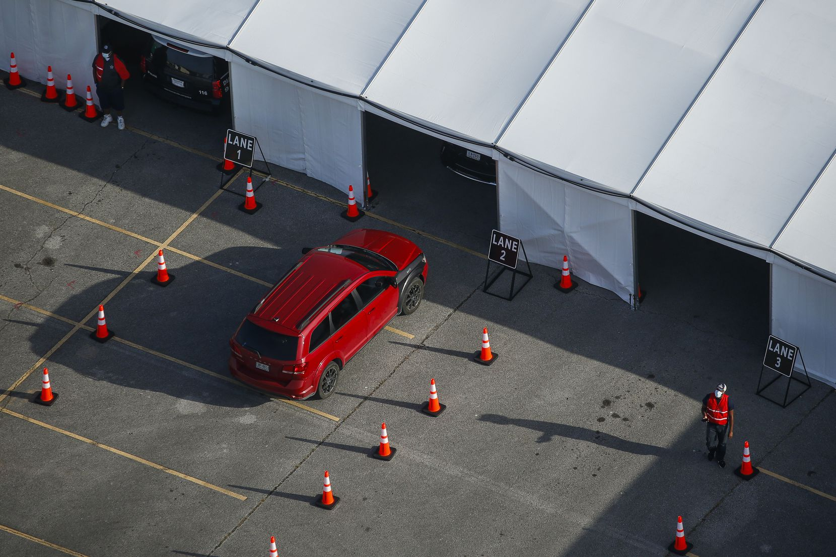 A car enters the testing tent at Ellis Davis Fieldhouse in Dallas on Friday.