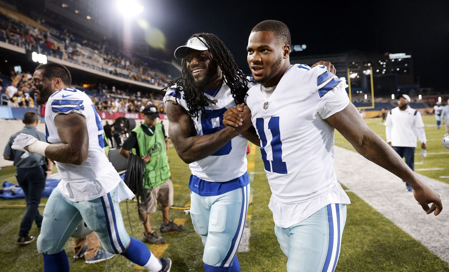 Dallas Cowboys linebacker Jaylon Smith (9) congratulates rookie linebacker Micah Parsons (11) after his first game. Parsons had a fumble recovery during their preseason game with the Pittsburgh Steelers at Tom Benson Hall of Fame Stadium in Canton, Ohio, Thursday, August 5, 2021. (Tom Fox/The Dallas Morning News)
