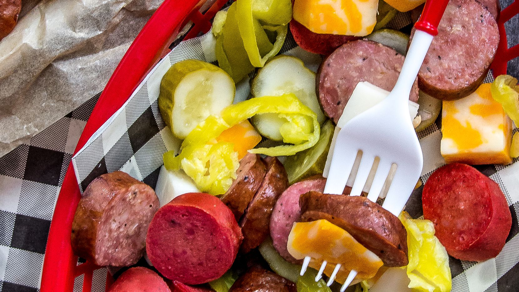 Sausage, Cheese and Pickle Platter is a recreation of a famous dish at Champy s Famous Fried Chicken.