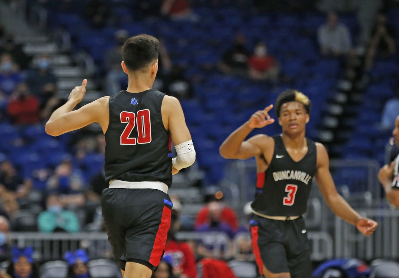 Duncanville Juan Reyna #20 celebrates his three. UIL boys Class 6A basketball state championship game between Duncanville and Austin Westlake on Saturday, March 13, 2021 at the Alamodome.