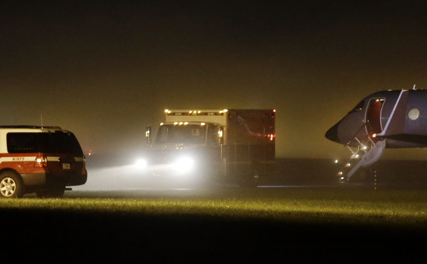 An ambulance with nurse Nina Pham aboard leaves Frederick Municipal Airport in Frederick, Md., headed to the National Institutes of Health Clinical Center in Bethesda.