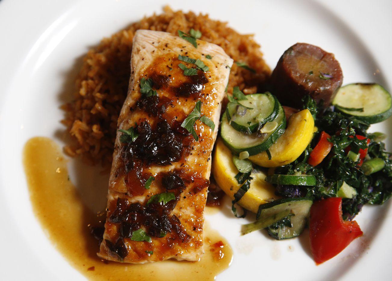 Mango jalapeño glazed salmon dish at Daylight Golf on Thursday, January 21, 2021in Grapevine, Texas. The sports bar restaurant features virtual golf.