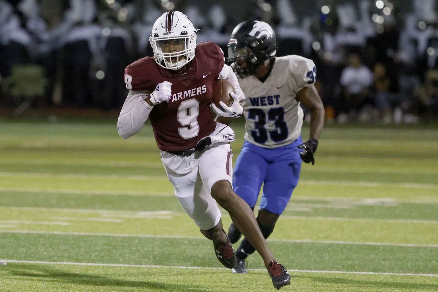 Lewisville receiver Amani Winfeild (9) runs past Plano West defender Johnnie Ingram (33O as he runs for a touchdown during the first half of a high school football game in Lewisville, Texas on Friday, Sept. 24, 2021. (Michael Ainsworth/Special Contributor)