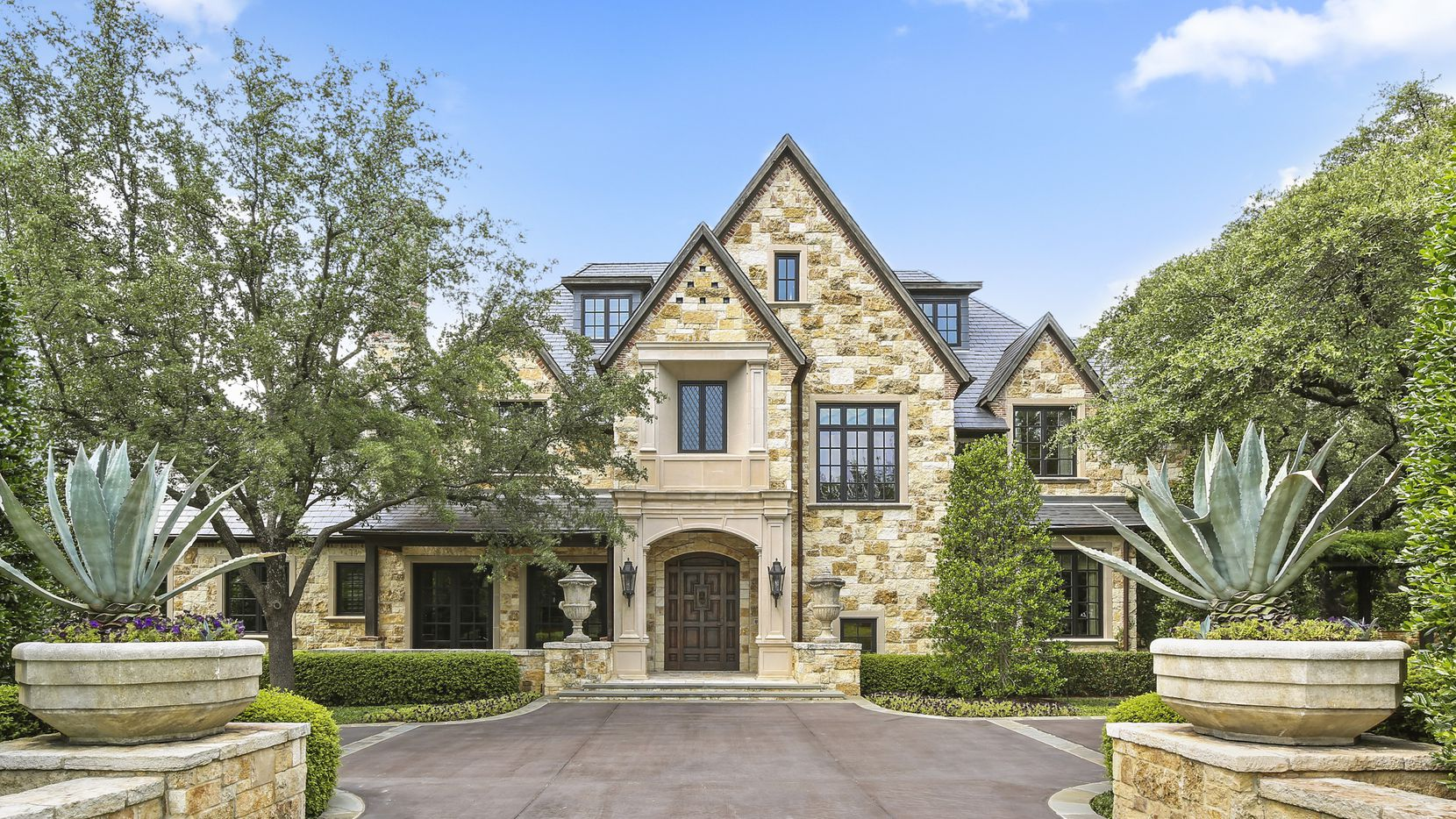 A 15,402-square-foot Old Preston Hollow home at 5031 Deloache is listed at a hefty $10,995,000.