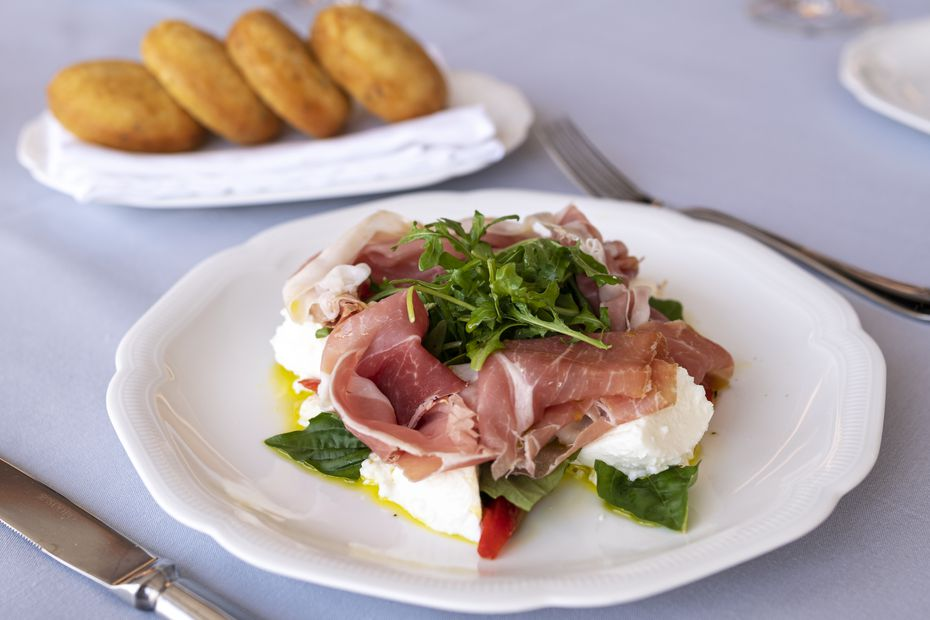 A popular starter at Monarch is prosciutto and Buffalo mozzarella served with crispy rosemary tigelle, pictured at the top.