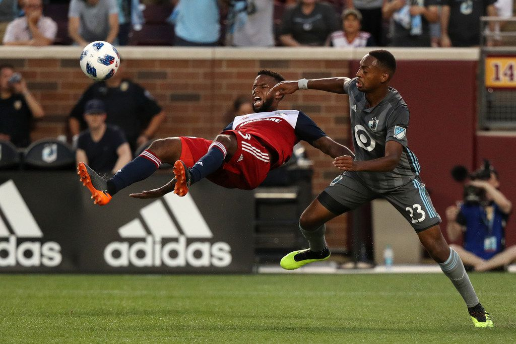 FC Dallas midfielder Kellyn Acosta (23) tries to clear the ball away from Minnesota United forward Mason Toye (23) in the second half on Friday, June 29, 2018, at TCF Bank Stadium in Minneapolis. FC Dallas won, 1-0. (Anthony Souffle/Minneapolis Star Tribune/TNS)