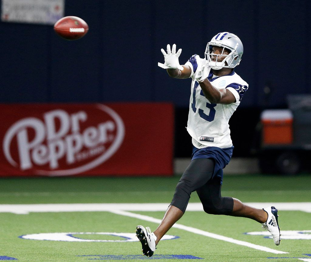 Dallas Cowboys wide receiver Michael Gallup (13) prepares to catch a pass during practice at Dallas Cowboys training camp at The Star in Frisco, Texas on Tuesday, August 28, 2018. (Vernon Bryant/The Dallas Morning News)