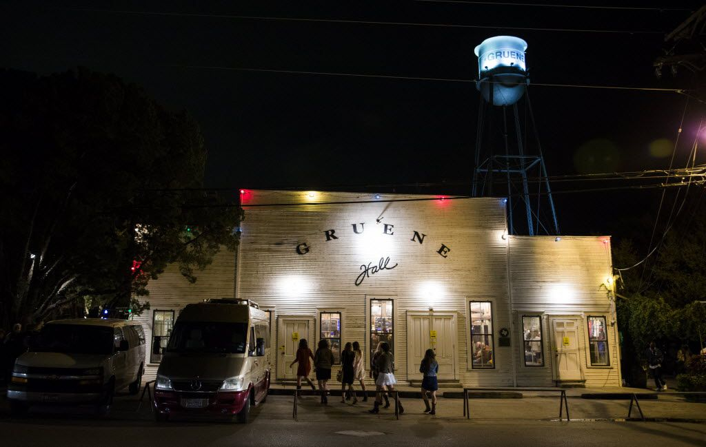 Women walk toward the entrance of Gruene Hall on Nov. 7, 2015 in New Braunfels.