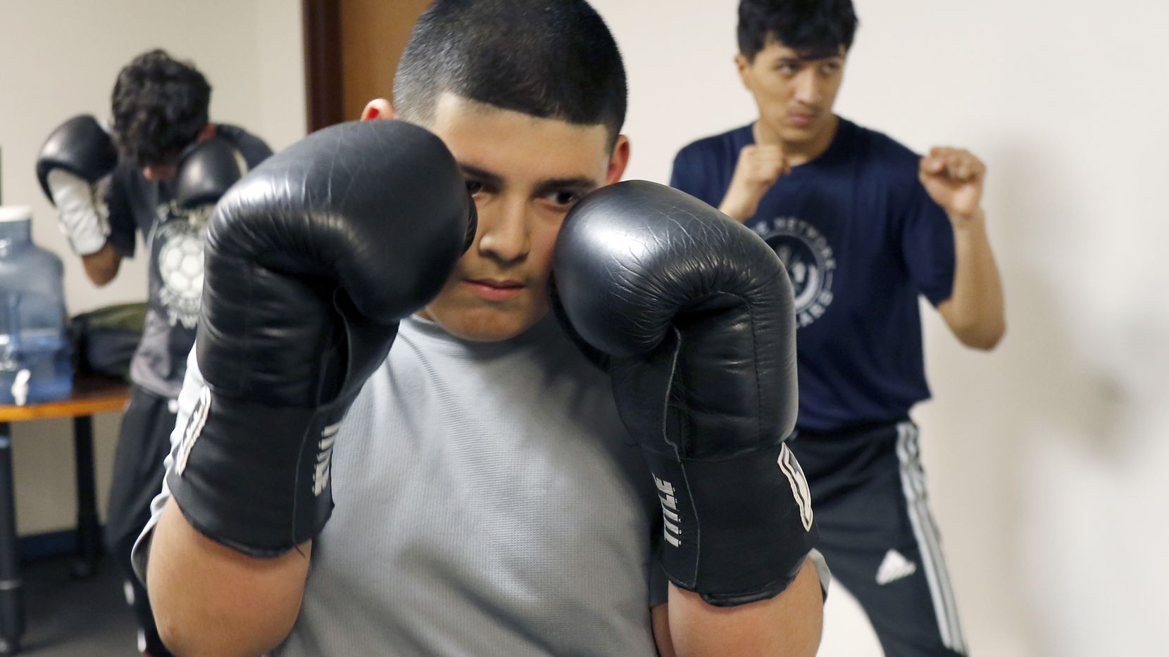 Daniel Abundis,12, is taking boxing classes to learn how to protect himself at the new physical location of nonprofit Puede Network in Oak Cliff, Texas on Thursday, December 12, 2019. The new location has a boxing and classroom space to use. For years, the group has met at the founder's Adan Gonzalez's childhood home and city parks, but a benefactor has loaned them a building to use free of rent.