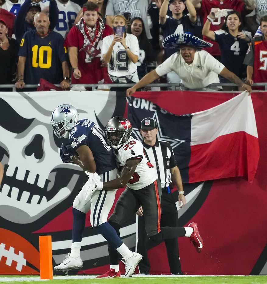 Dallas Cowboys wide receiver Amari Cooper (19) catches a touchdown  as Tampa Bay Buccaneers cornerback Jamel Dean (35) defends during the first half of an NFL football game at Raymond James Stadium on Thursday, Sept. 9, 2021, in Tampa, Fla. (Smiley N. Pool/The Dallas Morning News)