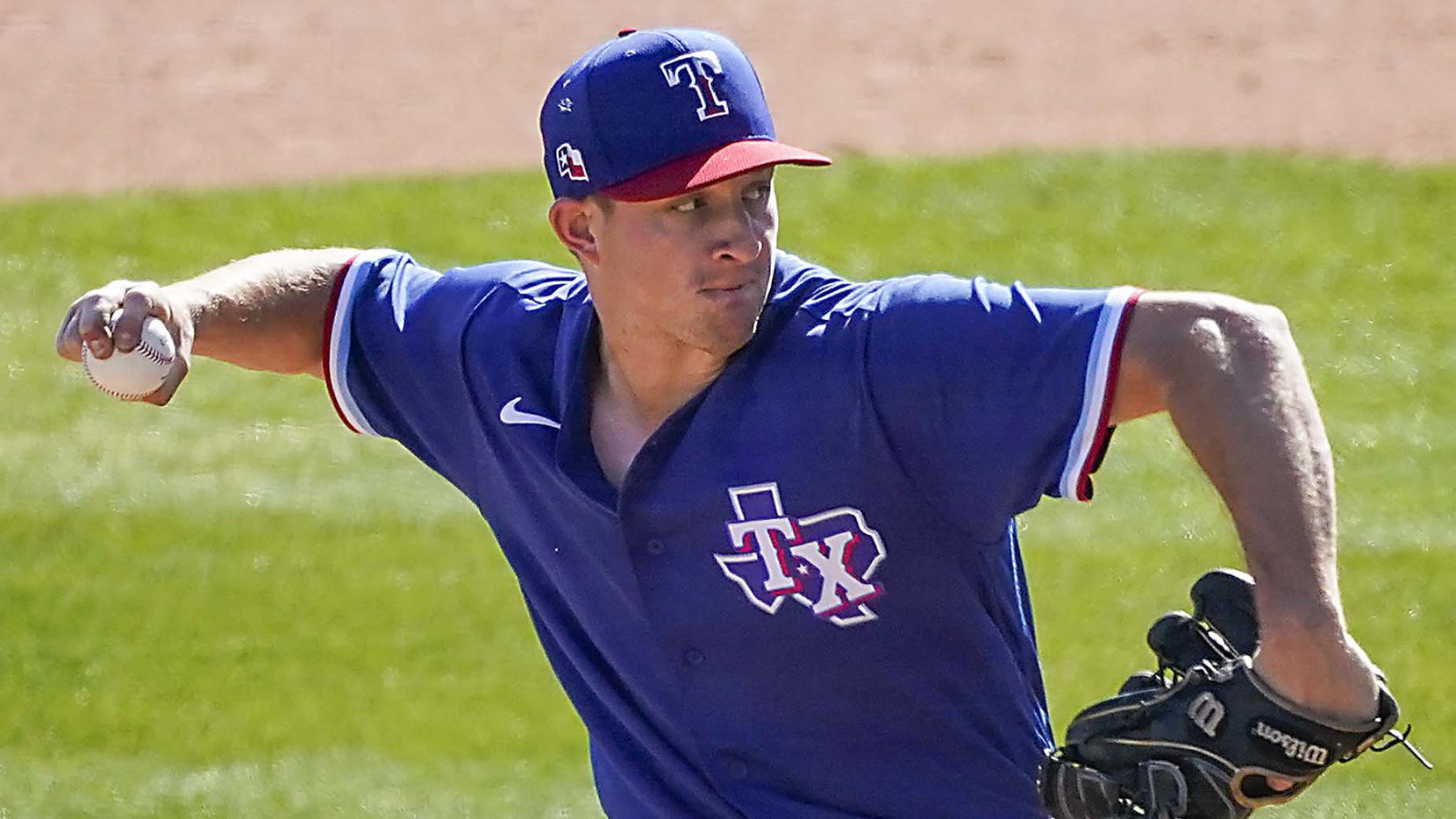 Rangers pitcher Brett de Geus delivers during the sixth inning of a spring training game against the White Sox at Camelback Ranch on Tuesday, March 2, 2021, in Phoenix.