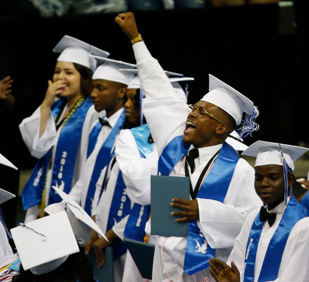 A graduate pumps his fist during the Wilmer-Hutchins High School graduation at Ellis Davis Field House in Dallas on June 2, 2018.