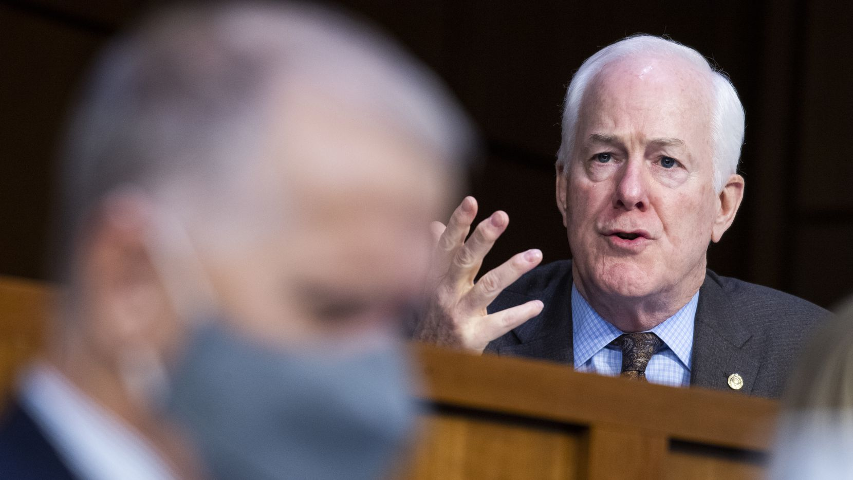 Sen. John Cornyn, R-Texas, right, speaks as Thom Tillis, R-N.C., listens during a confirmation hearing for Supreme Court nominee Amy Coney Barrett before the Senate Judiciary Committee, Tuesday, Oct. 13, 2020, on Capitol Hill in Washington.
