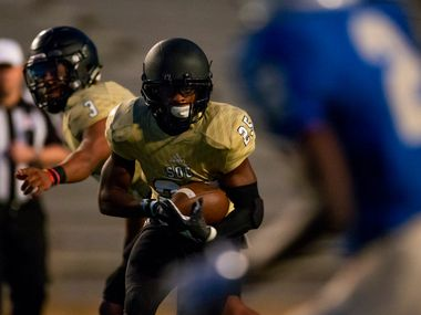 South Oak Cliff running back Cam Davis looks for running room against Conrad during a game in 2018.