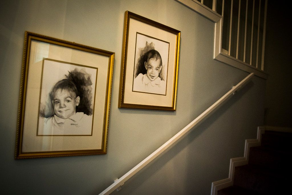 Baby images of Kara Zartler and her twin sister, Keeley, hang in the stairwell of the family home in Richardson. The girls were born three months premature. Keeley developed normally, but at 15 months, Kara was diagnosed with cerebral palsy.