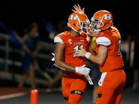 Rockwall's Jaxon Smith-Njigba (11) and Braedyn Locke (8) celebrate after connecting for a touchdown in a game against Arlington Martin High School during the first half of play at Wilkerson-Sanders Memorial Stadium in Rockwall, Texas on Friday, September 20, 2019. (Vernon Bryant/The Dallas Morning News)