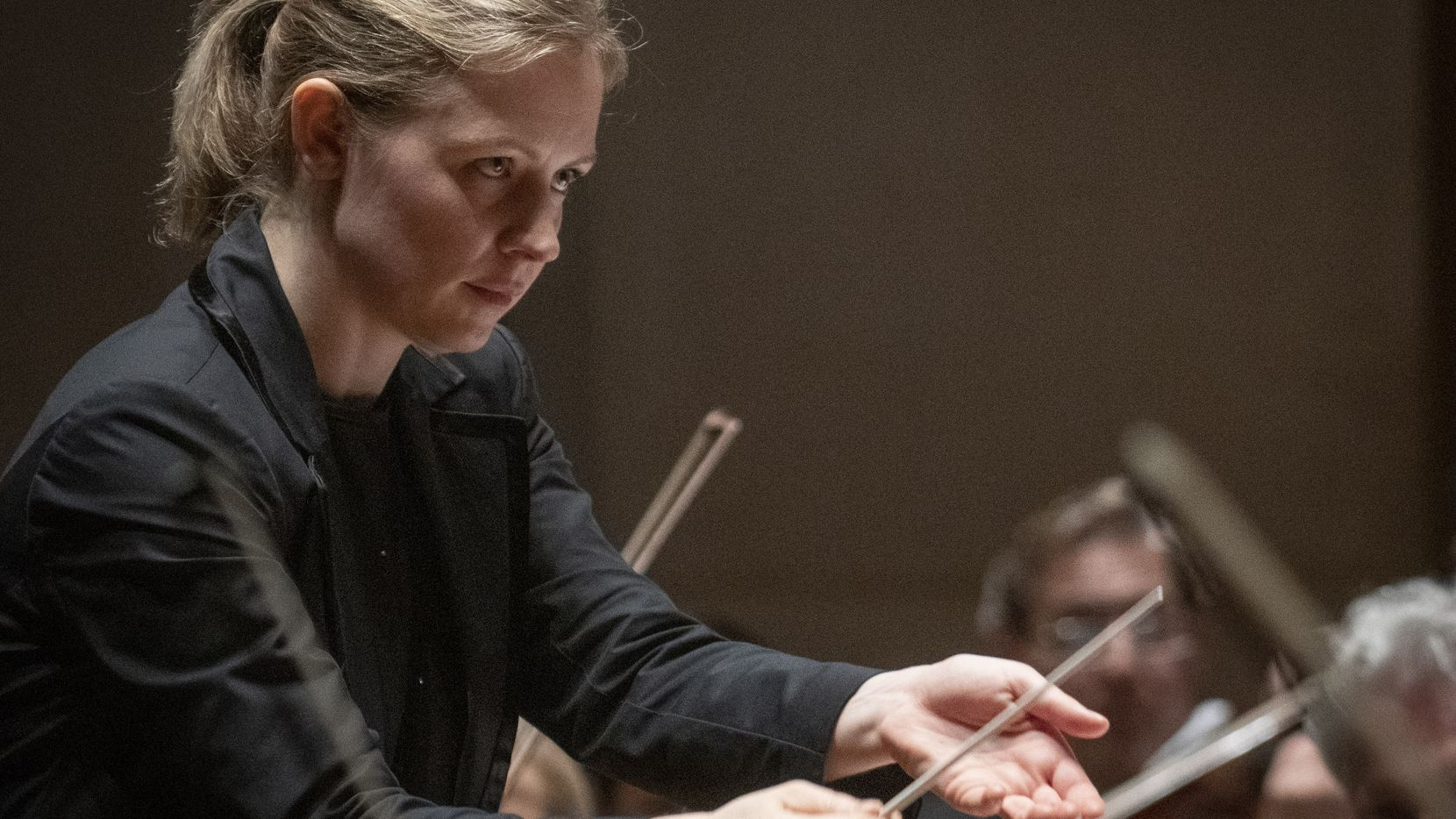Gemma New, the Dallas Symphony Orchestra's principal guest conductor, leads the orchestra at the Meyerson Symphony Center in Dallas.