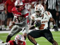 W.T. White Daviawn Bishop (2) looks for room against the Woodrow Wilson defense during the first half of a high school football game at Forester Field, Friday, September 24, 2021. (Brandon Wade/Special Contributor)