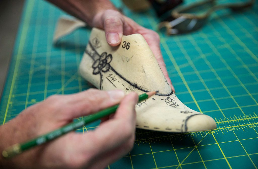 Kai Harrison works in the design room on Friday, June 14, 2019 of the Harrison family owned J. Renee shoe company in Carrollton, Texas.