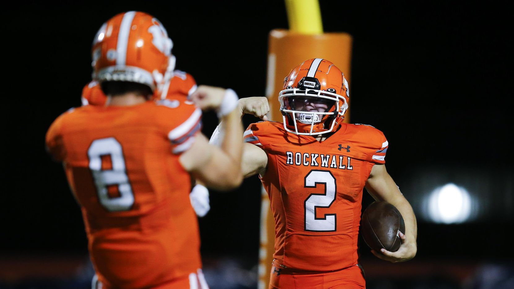 Rockwall junior running back Zach Hernandez (2) is congratulated by senior quarterback Braedyn Locke (8) after scoring a touchdown during the first half of a high school football game against Jesuit at Wilkerson-Sanders Stadium in Rockwall, Friday, September 3, 2021.