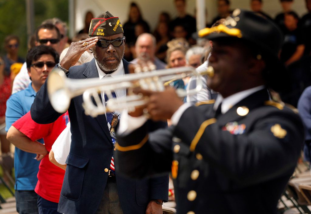 Retired Vietnam War Army veteran Clarence Jackson salutes as Taps is played by Spc. Phillip Smith of the U.S. Army 1st Cavalry Division Band during a Memorial Day ceremony at Dallas-Fort Worth National Cemetery on Monday.