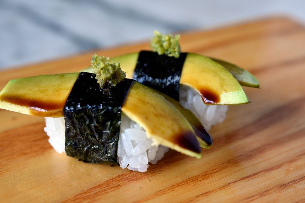One of Uchi and Uchiba's best bites -- and also one of its least expensive -- is the avocado nigiri with yuzu kosho, a simple bite of avocado over rice.
