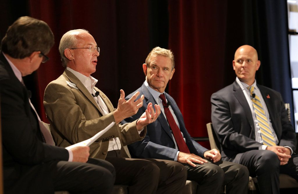 John Lettelleir, (second from left) director of development services for the city of Frisco, took part in a panel discussion during a Frisco Chamber of Commerce State of the City event on Tuesday. With him are Craig Hall, center, the chairman and founder of The Hall Group, and Darrel Amen, land development manager with Woodbine Development Corporation.