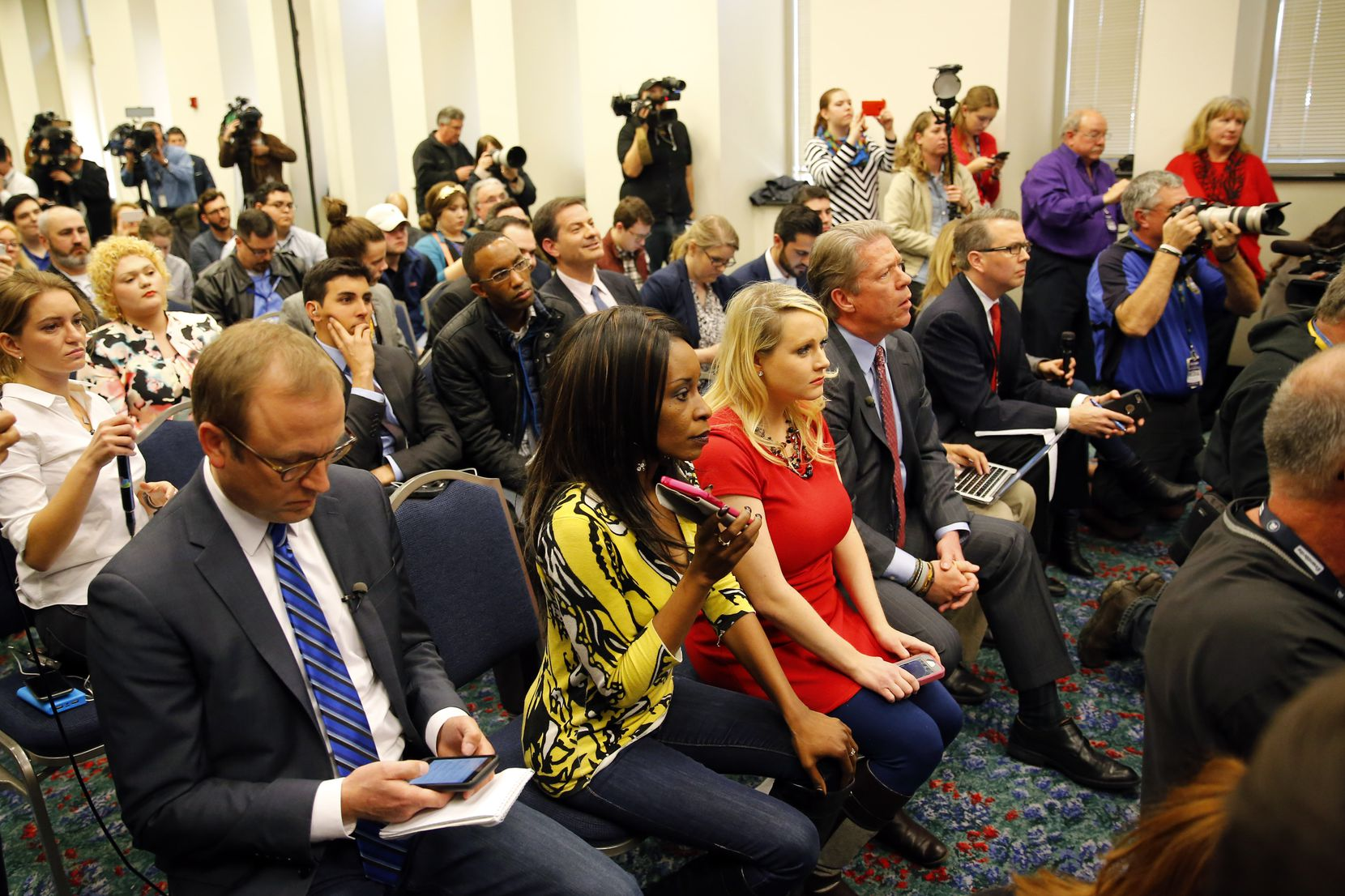 KLIF radio show host Nicole Barrett (second from right in yellow top) asked a question of Republican presidential candidate Donald J. Trump about the endorsement of former Grand Wizard of the Ku Klux Klan David Duke during a press conference at the Fort Worth Convention Center in downtown Fort Worth, Friday, February 26, 2016. She was the first to inform Trump of the endorsement. Trump is campaigning in Texas ahead of the Super Tuesday elections next week.