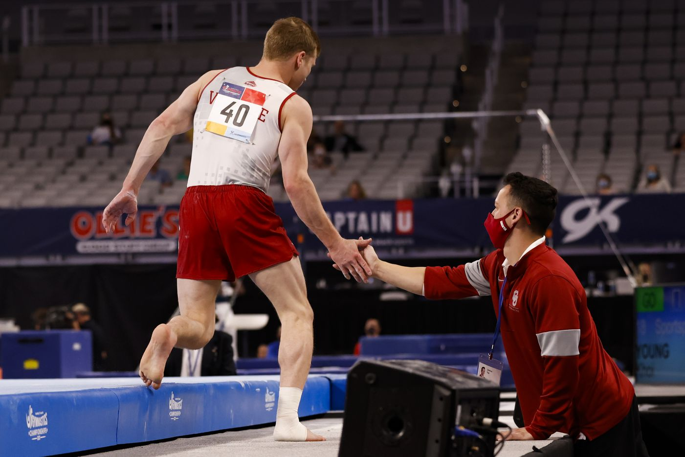 University of Oklahoma's Matt Wenske high fives assistant coach Josh Yee after completing the floor routine during Day 1 of the US gymnastics championships on Thursday, June 3, 2021, at Dickies Arena in Fort Worth. (Juan Figueroa/The Dallas Morning News)