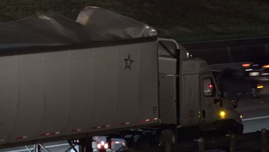 An 18-wheeler's trailer lies exposed after it burst open Wednesday morning in Euless.