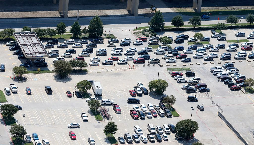People wait in line to get gas at the Costco at Sam Rayburn Tollway and Interstate 35 in Lewisville on Thursday.