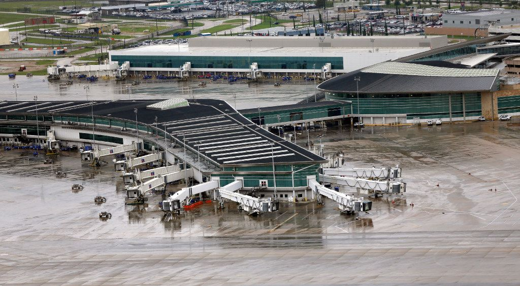 Empty gates at Hobby Airport are shown Tuesday, Aug. 29, 2017, in Houston. The airport has been closed since Hurricane Harvey made landfall. (AP Photo/David J. Phillip)