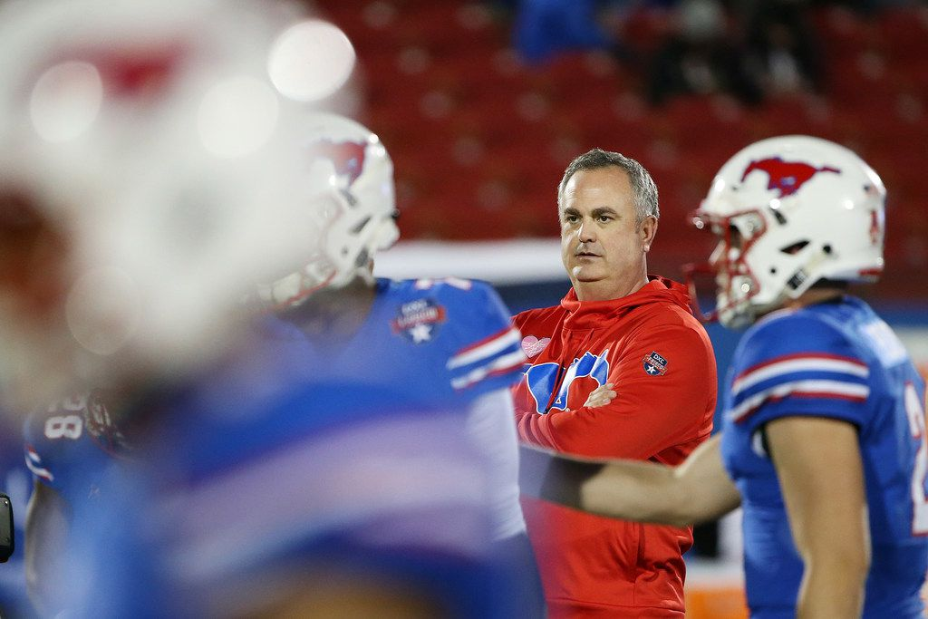 New Southern Methodist Mustangs head coach Sonny Dykes watches his team warm up before the NCAA 2017 DXL Frisco Bowl between the Louisiana Tech Bulldogs and the SMU Mustangs at Toyota Stadium in Frisco, Texas, Wednesday, Dec. 20, 2017. (Andy Jacobsohn/The Dallas Morning News)