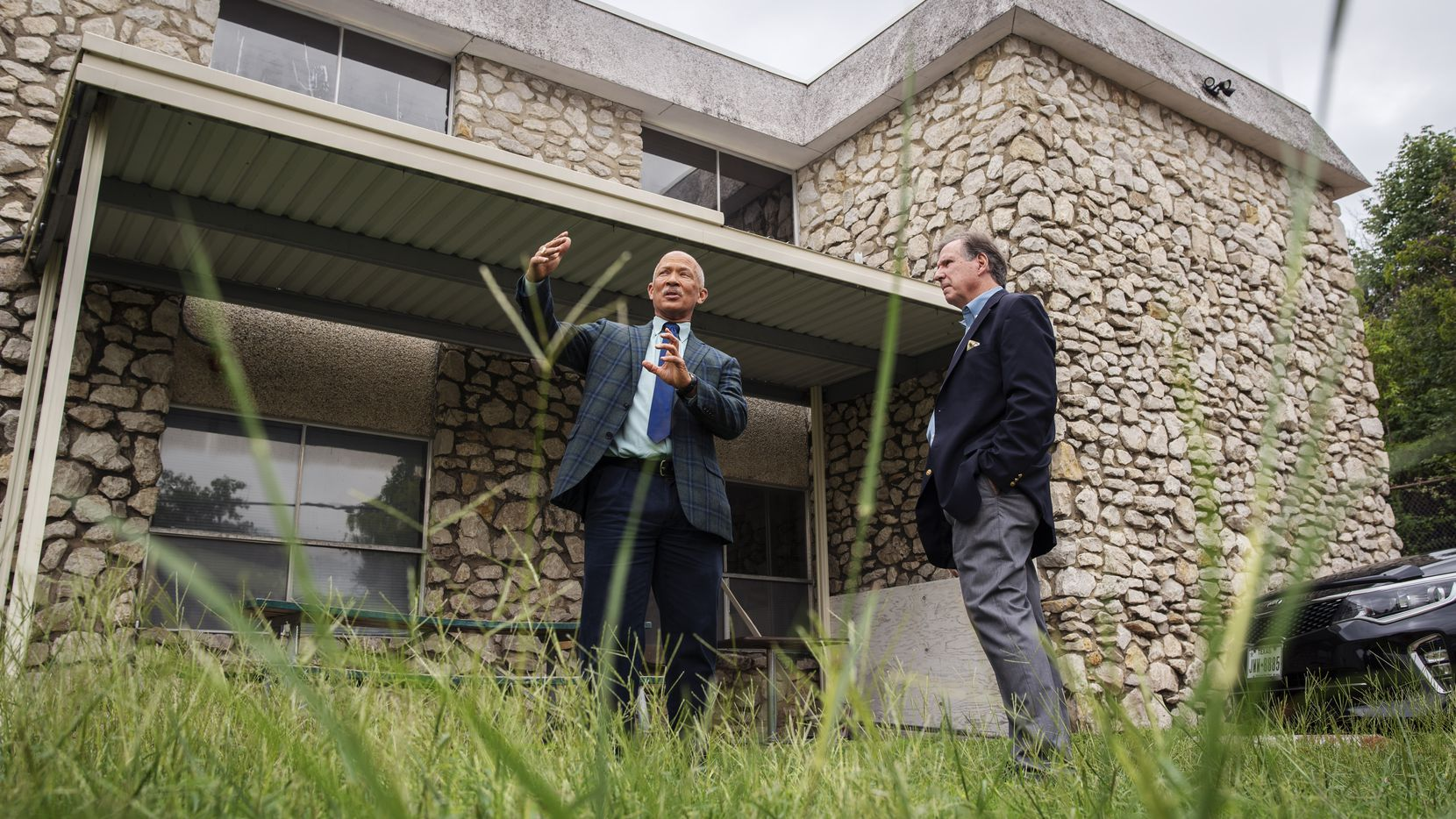 Dallas County District Attorney John Creuzot, left, and Homeward Bound executive director Doug Denton near what will they hope will become the entrance to a new deflection center at Homeward Bound. County commissioners are scheduled to vote Tuesday on necessary renovation funds for the center as part of their 2021 budget decisions.