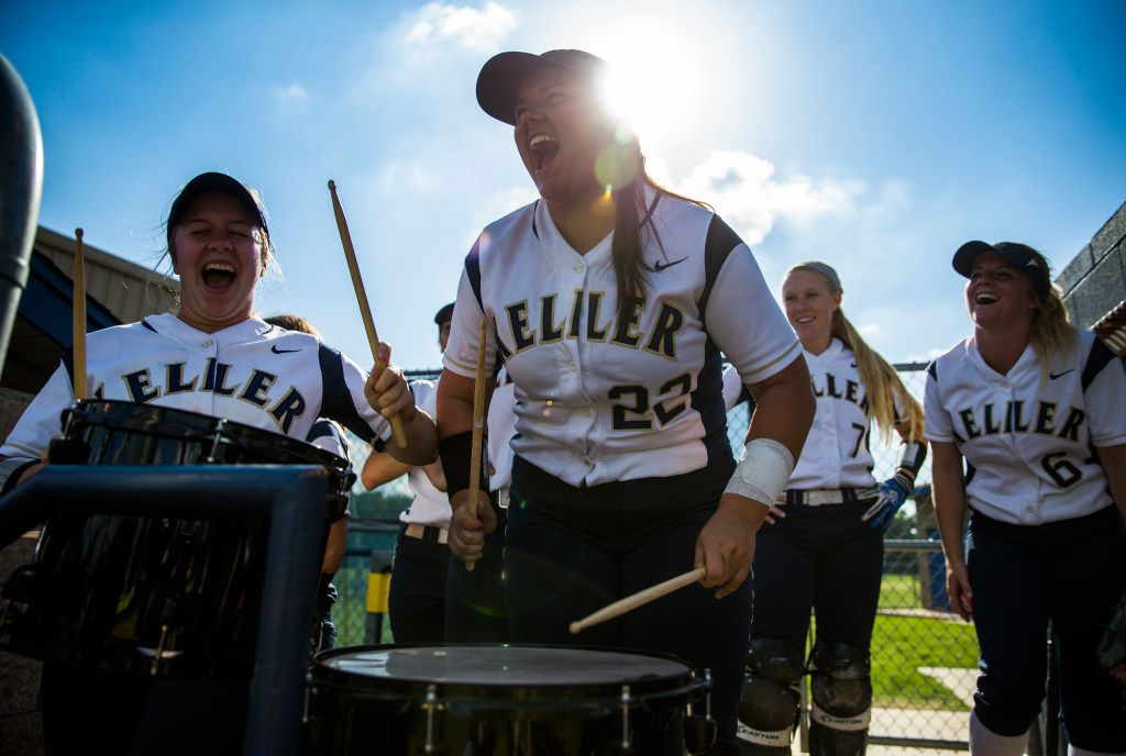 Keller's Dylann Kaderka (22, center) leads her team in a drum chant in the dugout during the first inning of a high school softball game between Keller and Timber Creek High Schools on Tuesday, April 18, 2017 at Keller High School in Keller, Texas. (Ashley Landis/The Dallas Morning News)