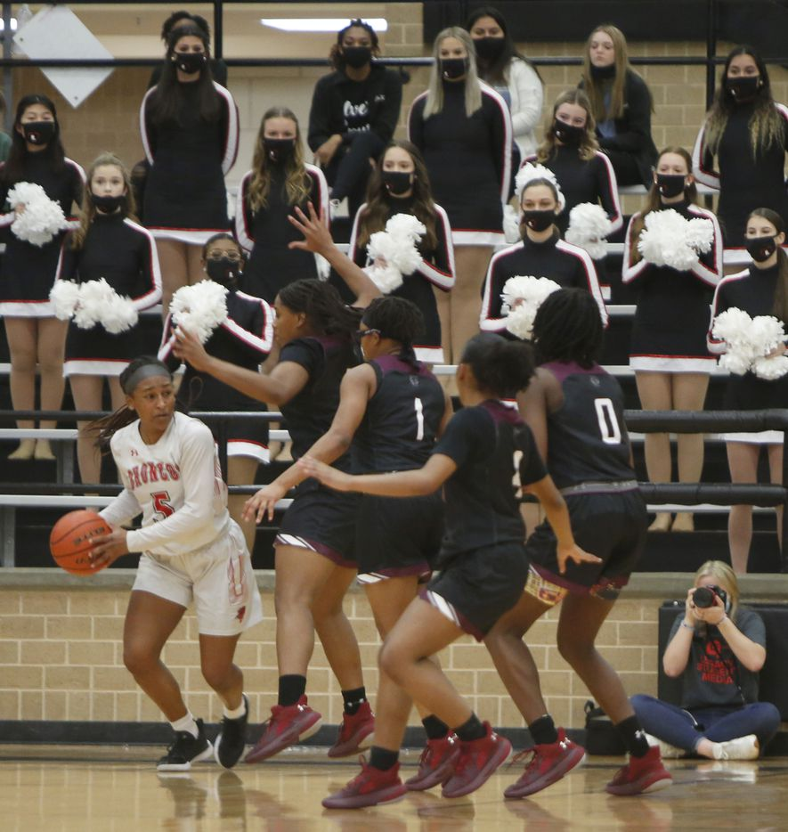 Mansfield Legacy guard Savannah Catalon (5) looks to make an outlet pass as she is surrounded by a host of Mansfield Timberview defenders during first half action. The two teams played their District 8-5A girls basketball game at Mansfield Legacy High school on January 22 , 2021. (Steve Hamm/ Special Contributor)