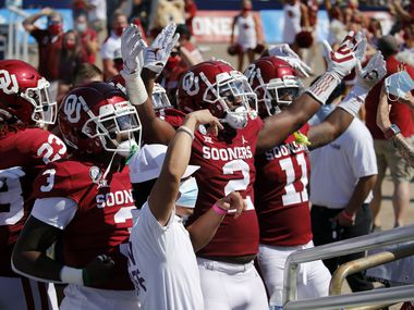 Oklahoma Sooners linebacker David Ugwoegbu (2) and the rest of the defense celebrate a  blocked punt before fans in the second quarter of the Red River Rivalry. Oklahoma won in quadruple overtime, 53-45, at the Cotton Bowl in Dallas, Saturday, October 10, 2020.