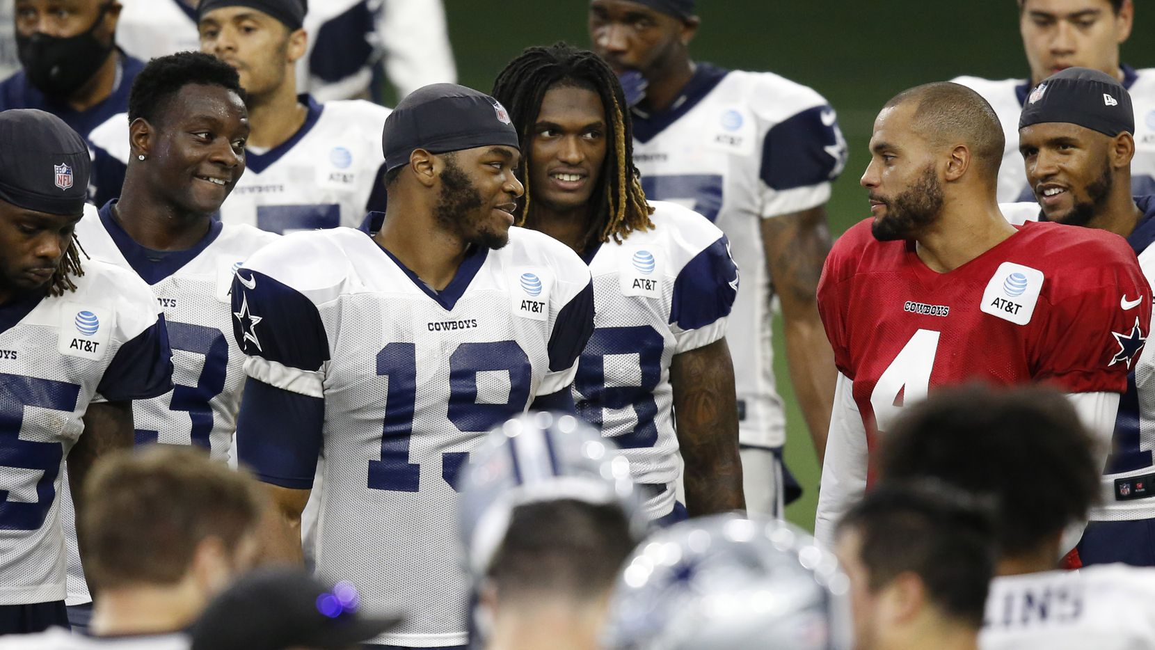 Dallas Cowboys quarterback Dak Prescott (4) talks with Dallas Cowboys wide receiver Michael Gallup (13), Dallas Cowboys wide receiver Amari Cooper (19), and Dallas Cowboys wide receiver CeeDee Lamb (88) after practice during training camp at the Dallas Cowboys headquarters at The Star in Frisco, Texas on Thursday, August 27, 2020.