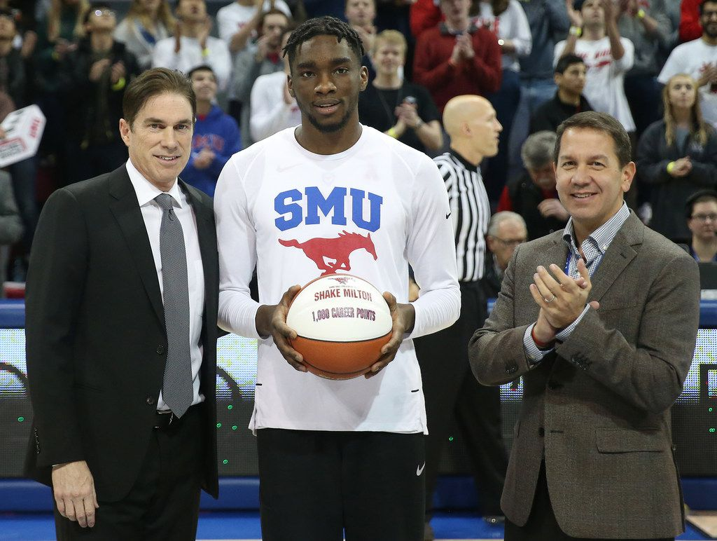 SMU guard Shake Milton (1) receives a commemorative ball denoting 1,000 career points from coach Tim Jankovich (left) and athletic director Rick Hart before an NCAA basketball game against Temple at Moody Coliseum in Dallas Wednesday January 10, 2018. (Andy Jacobsohn/The Dallas Morning News)